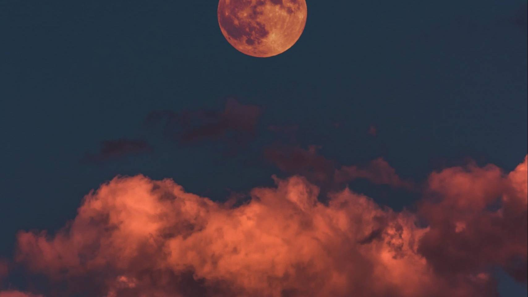 the moon and colorful sky