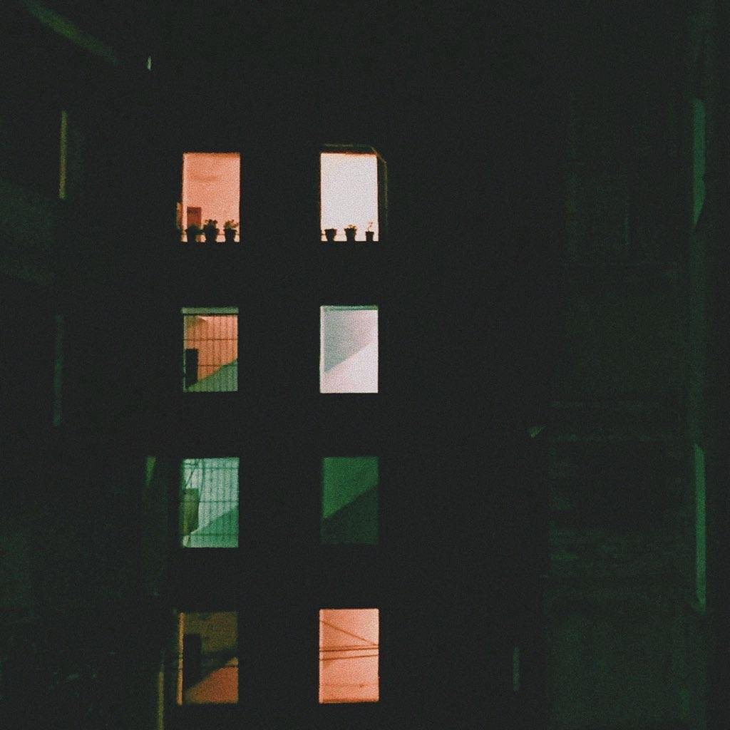 a building with windows lit in different hues