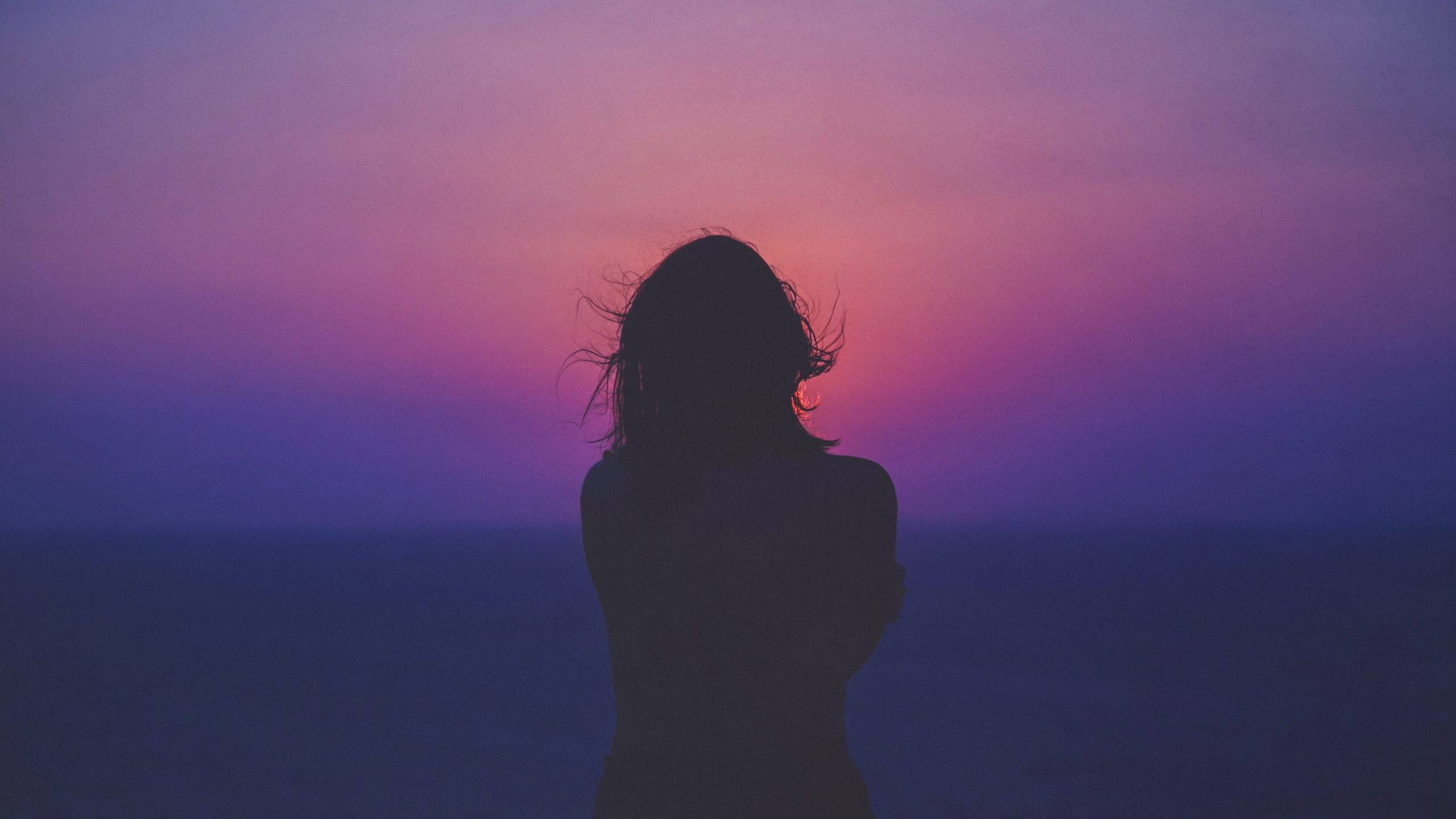 woman silhouette against sunset